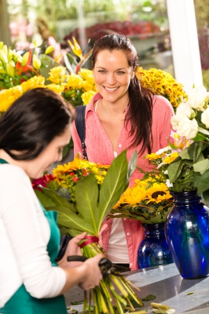 Cheerful woman buying bouquet flower shop florist cutting market Stock Photo - 17692553