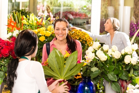 Young woman buying bouquet flower shop colorful customer Stock Photo - 17692450