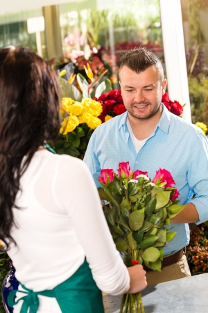 Husband buying roses bouquet romantic flower market florist Stock Photo - 17692546
