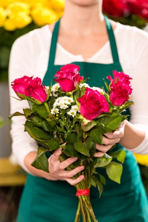 Female holding bouquet flowers pink roses flower shop photo