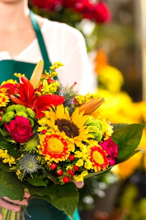 colorful bouquet flowers florist holding flower market shop assistant photo