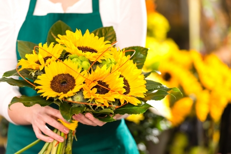 Bouquet sunflowers flower shop female florist holding photo