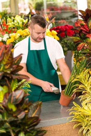 Florist man reading barcode potted plant shop market flower Stock Photo - 17692457