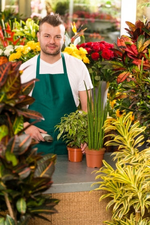 Young man scanning barcode flower shop gardening florist Stock Photo - 17690746