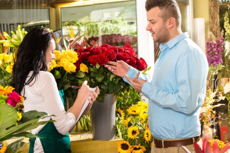 Man customer ordering flowers bouquet flower shop florist photo