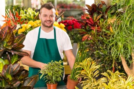flower shop: Happy male florist working flower gardening shop