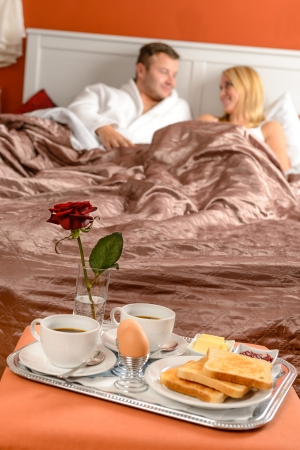 Happy married couple lying bed romantic breakfast hotel Stock Photo - 17887300