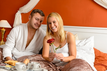 Smiling couple sitting in bed breakfast celebrating Valentine's day Stock Photo - 17887254