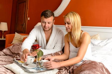 Romantic breakfast hotel room loving couple in bed Stock Photo - 17887259