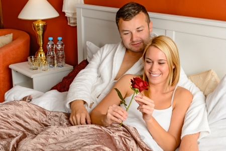 Loving couple celebrating romantic anniversary rose lying bed Stock Photo - 17887262