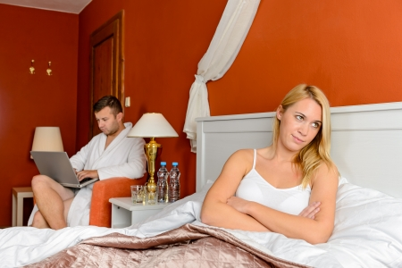 Resentful girl sitting bed room after fight boyfriend Stock Photo - 17887297