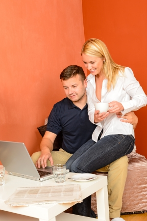 Happy couple sitting looking laptop man holding woman Stock Photo - 17887252