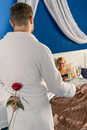 Man passionate flirting affair mistress rose champagne bedroom Stock Photo - 17887251