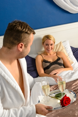 Husband flirting wife bedroom romantic evening celebration sexy nightgown photo