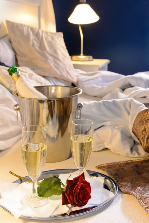 Champagne rose in bed celebrate special occasion hotel bedroom Stock Photo - 17887294