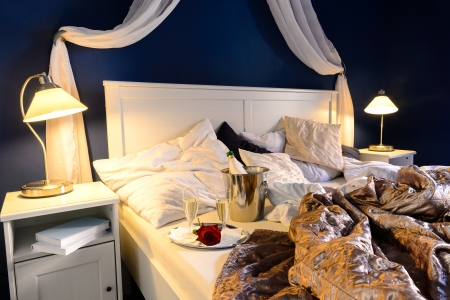 Rumpled sheets luxury hotel bedroom romantic night unmade bed Stock Photo - 17887257