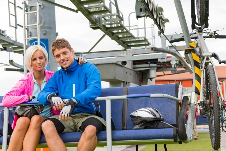 Young couple sitting on chair lift waiting for departing Stock Photo - 18599417