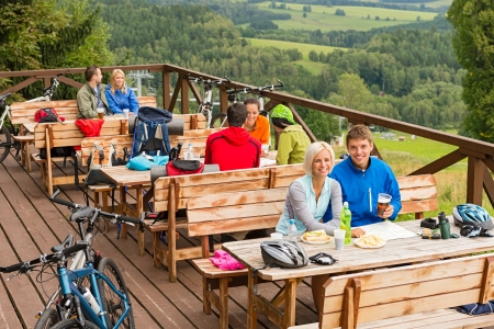 lipno: Young people relaxing looking at scenic mountain landscape  summer holiday