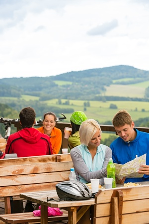 lipno: Smiling young couple resting looking at map sitting mountain countryside Stock Photo