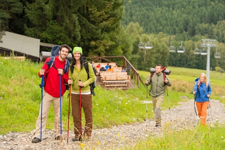 lipno: Young adventurous hiker couples following track up on the hill