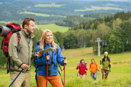 lipno: Young hiker friends reading map in natural landscape Stock Photo
