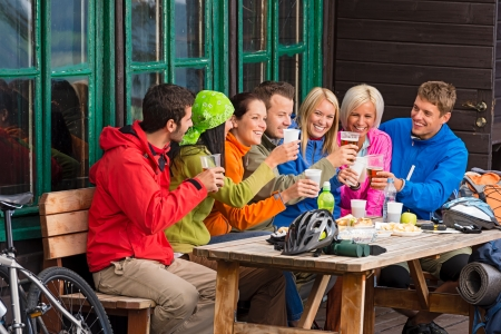 lipno: Happy young people resting and drinking beer after biking