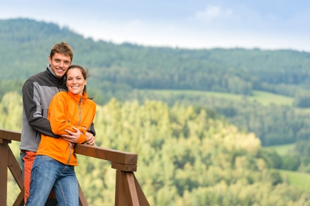 lipno: Cuddling couple on a summer weekend at the top of the mountain