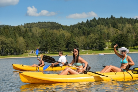 Friends enjoying summertime kayaking on river holiday freetime Stock Photo
