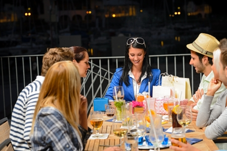 marina life: Young friends celebrating outdoors birthday party marina terrace restaurant