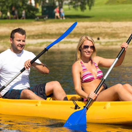 lipno: Young couple kayaking summertime in the sunshine vacation
