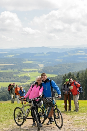 Posing cyclist couple on the mountain top with bikes Stock Photo - 18881871