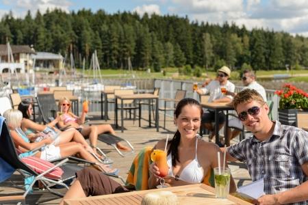 lipno: Young people enjoying summer vacation sunbathing drinking at beach bar Stock Photo