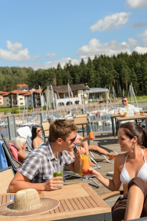 lipno: Young couple drinking cocktail at beach bar summertime