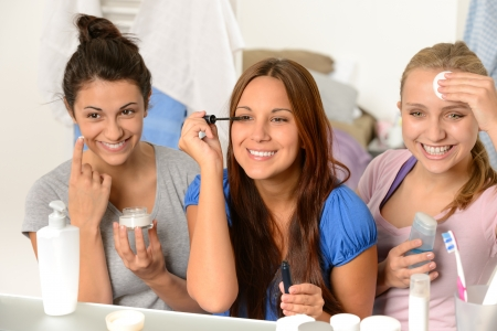 beauty product: Three teenager girls enjoying getting ready in the bathroom