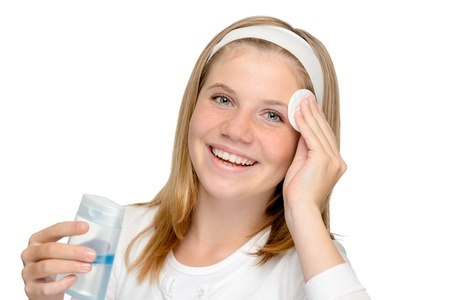 Young cheerful girl removing make-up cleansing pad cleaning water facial Stock Photo - 18969704