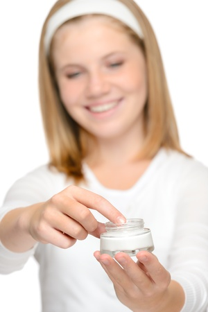 Smiling young girl applying moisturizer cream face beauty Stock Photo - 18969701