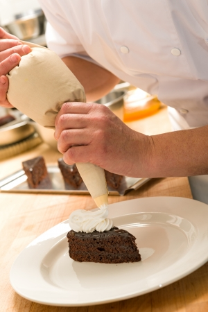 pastry bag: Cook decorating cake with whipped cream with piping technique