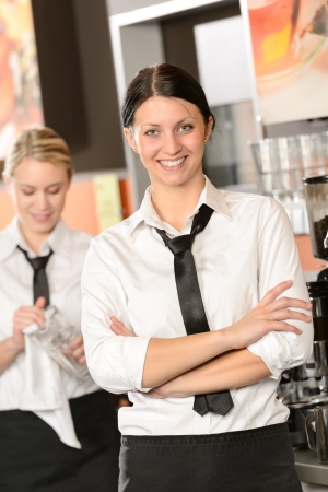 Confident waitress posing in cafe in uniform Stock Photo - 19379808