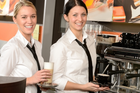 Cheerful waitresses serving hot coffee in bar in uniform Stock Photo - 19379817