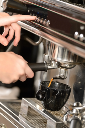 Close up of hands making coffee with espresso machine
