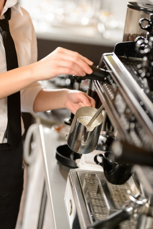 Barista steaming milk for hot cappuccino with machine Stock Photo - 19379813