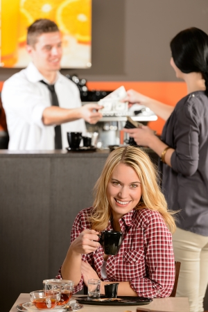 Happy female customer drinking espresso in cafe looking at camera Stock Photo - 19379819