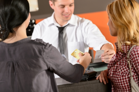 paying: Customers paying by credit card in pub Stock Photo