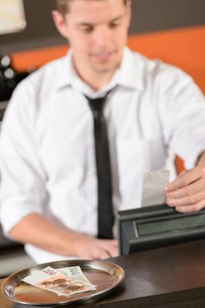 cashier: Young bartender in uniform taking cash czech crowns in bar Stock Photo