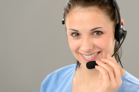 Friendly support phone operator woman wearing headset Stock Photo - 19379797
