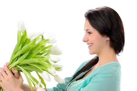 elated: Elated young woman with bouquet of white flowers
