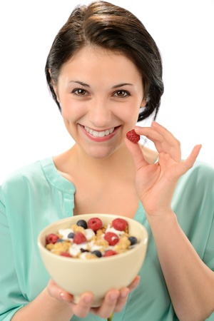 Friendly girl posing with cereal bowl and berries Stock Photo - 19379796