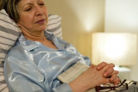 Peaceful portrait of sleeping old woman in bed Stock Photo - 19458866