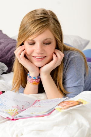 fantasizing: Friendly girl fantasizing over her diary about first love