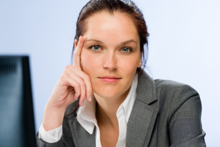 Calm confident businesswoman looking at camera photo